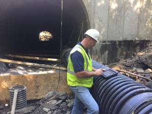 Worker on iPad near tunnel