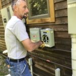 green mountain power technician installs netmeter