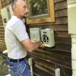 green mountain power technician installs netmeter